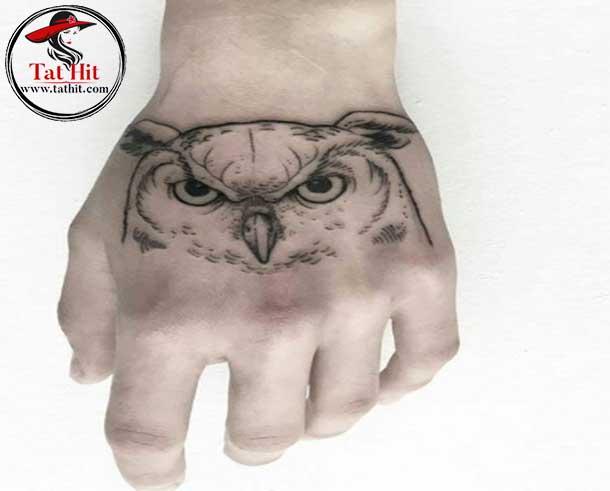 tiny great horned owl head tattoo