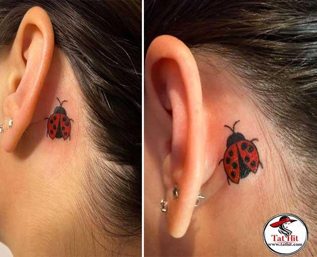 behind ear ladybug tattoo