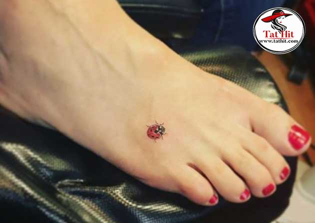 small ladybug tattoo on foot