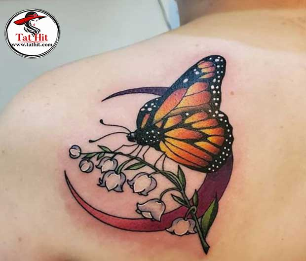 butterfly and lily of the valley tattoo idea