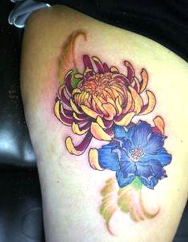 Attractive Larkspur Flower Tattoo On Thigh
