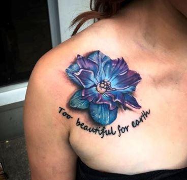 Beautiful Larkspur Flower Tattoo On Chest