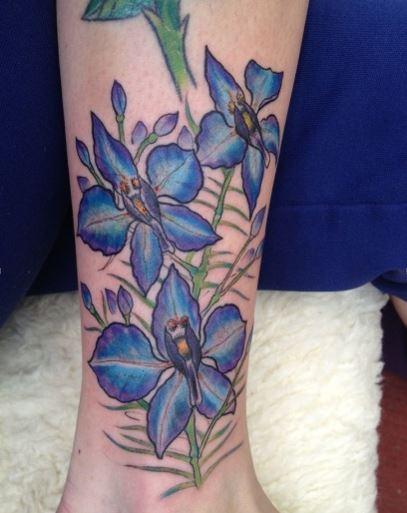 Blue Larkspur Flower Tattoo On Leg