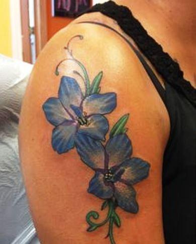 Brilliant Larkspur Flowers Tattoo On Shoulder