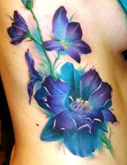 Cool Larkspur Flower Tattoo On Rib