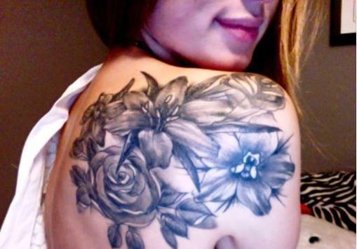 Grey Larkspur Flower Tattoo On Shoulder