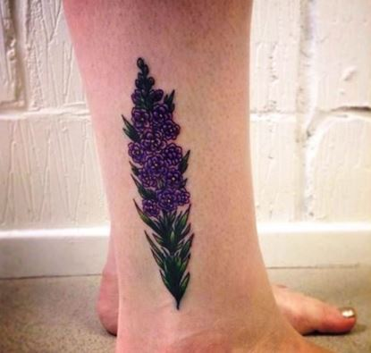 Small Larkspur Flower Tattoo On Leg